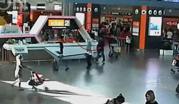 A still image from a CCTV footage appears to show (circled in red) a man purported to be Kim Jong Nam being accosted by a woman in a white shirt at Kuala Lumpur International Airport in Malaysia on February 13, 2017.