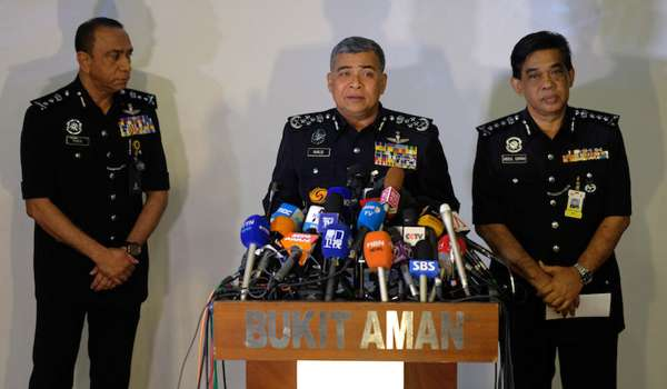 Inspector General of Police Tan Sri Khalid Abu Bakar (centre) said investigators discovered the powerful neuro-toxin on swabs taken from Kim Jong-nam's eyes and face.